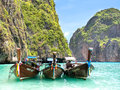 Longtail boats in maya bay ko phi phi thailand long tail bobbing the turquoise waters of Royalty Free Stock Photography