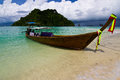 Longtail boats on a tropical island Stock Image