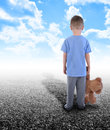Lonley Boy Standing Alone with Teddy Bear Stock Photo