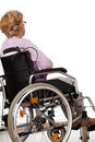 Lonley disabled elder woman sitting alone on wheelchair Royalty Free Stock Photo