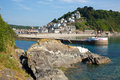 Looe harbour and beach cornwall england cornish coast at fishing port on a sunny day Stock Photography
