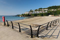 Looe seafront cornwall england beach with blue sea and sky on a sunny summer day Royalty Free Stock Photography