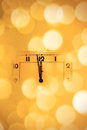 Look at the clock a little before midnight abstract blurred bokeh background new year's concept Stock Photos