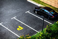 Look down empty parking spot with vegetation and shrubbery from above Stock Image
