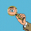 Look through a magnifying glass searching eyes pop Royalty Free Stock Photo