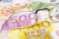 Look at the money glasses placed on euro banknotes for your financial bonus cashback gifts and presents copy note that is real and Royalty Free Stock Images