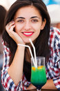 Look in my eyes gorgeous latina woman with beautiful brown smiling with cocktail Royalty Free Stock Images