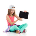 Look at my new digital tablet smiling young girl holding full length studio shot on white Stock Photos