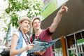 Look what we have there happy young couple as tourists with a map Royalty Free Stock Images