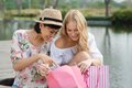 Look what i ve bought image of two young women looking in the shopping bags Royalty Free Stock Image