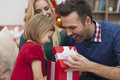Look what santa claus brought you she always know give us in christmas Royalty Free Stock Image