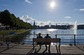 Looking at the alster lake hamburg germany september a couple seated on a bench look on september in hamburg germany Royalty Free Stock Image