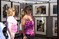 Looking at art women paintings festival from las olas fair in ft lauderdale florida on oct Stock Photo