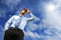 Looking away to a better future young business man against blue sky Royalty Free Stock Images