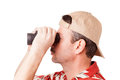 Looking through binoculars man in hawaiian shirt is isolated on white Royalty Free Stock Photography