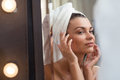 Looking at complexion young woman is her after bath Stock Photo