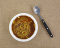 Looking down bowl spicy couscous minestroni soup spoon Stock Photos