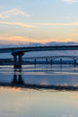 Looking down the Illinois River at steel bridges at sunset Royalty Free Stock Photo