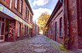 Looking down a long colorful alley HDR Royalty Free Stock Photo