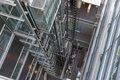 Looking downwards in a modern open elevator shaft an of office building Royalty Free Stock Image
