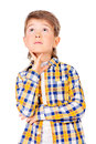 Looking dreamily cute years old boy standing and up isolated over white Stock Photography