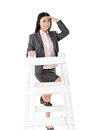 Looking far away asian business woman on a ladder isolated on white background Stock Image