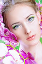 Looking fixedly beautiful girl with flowers in her hair spring Royalty Free Stock Photography