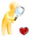 Looking for love concept of a person at a heart shaped symbol with a magnifying glass Stock Photos