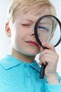 Looking through magnifying glass Royalty Free Stock Photos