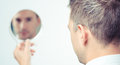 Looking in the mirror and reflecting a business man is a hand on himself Royalty Free Stock Photo