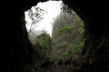 Looking out through a cave on volcanic island Royalty Free Stock Photography