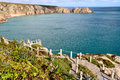 Looking over porthcurno beach cornwall towards logan rock as viewed minack theatre Stock Photography