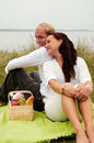 Looking over shoulder on romantic picnic Royalty Free Stock Image