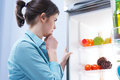 Looking in the refrigerator Royalty Free Stock Photo