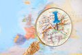 Looking in on skopje macedonia blue tack map of europe with magnifying glass Royalty Free Stock Images