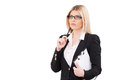Looking for solution thoughtful mature businesswoman holding clipboard and touching her chin with pen while standing isolated on Stock Images