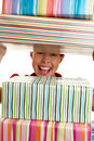 Looking through stack of gifts Royalty Free Stock Photography