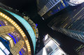Looking straight up from the center of times square in the eveni at midtown manhattan scene features plenty neon signs Stock Photos