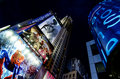 Looking straight up from the center of times square in the eveni at midtown manhattan scene features plenty neon signs Royalty Free Stock Photography