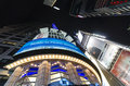 Looking straight up from the center of times square in the eveni at midtown manhattan scene features plenty neon signs Royalty Free Stock Images