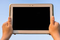 Looking at tablet hand holding in the sky screen Royalty Free Stock Images