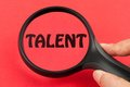 Looking for talent concept with a magnifier on hand Stock Photography