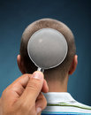 Looking to a head through magnifying glass Royalty Free Stock Photo