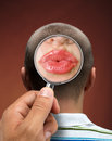 Looking to a head mans thinking about women through magnifying glass Royalty Free Stock Photos
