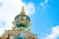 Looking up at giant statue at Grand palace, Temple of the Emerald Buddha (Wat pra kaew) in Bangkok ,Thailand.