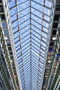 Looking up at the glass and steel ceiling of a huge exhibition hall Stock Photo