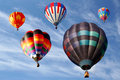 Looking up at Hot Air Balloons in the Cloudy Sky Stock Photography