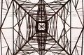 Looking up interior of large electrical tower frame. Royalty Free Stock Photo