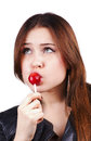 Looking up pretty woman licks lollipop Stock Photos