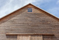 Looking up the top of gabled roof on a wooden barn at Royalty Free Stock Image